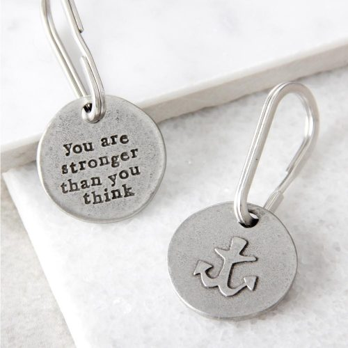 """Round metal keyring with """"you are stronger than you think"""" on one side and a picture on an anchor on the other"""