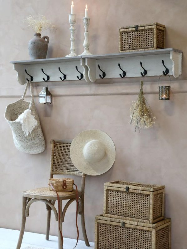 Basket displayed on set of pegs with other accessories