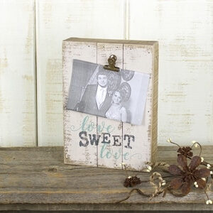 """Rustic wooden block with a clip on it to attach a phot. THe words """"Love sweet love"""" printed on"""