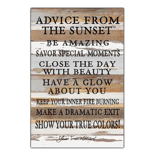 Planks of distressed wood collated to make a picture board with inspirational wording printed on it