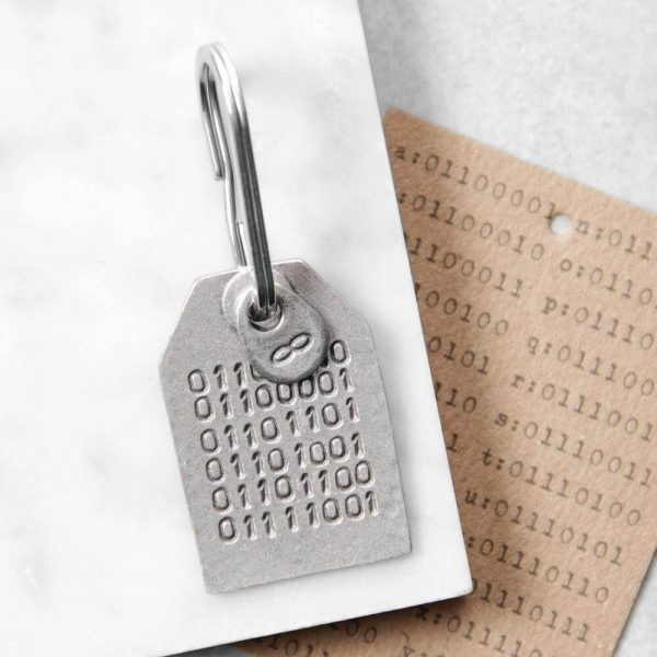 A keyring with lines of 0 and1 on that make up a message in binary