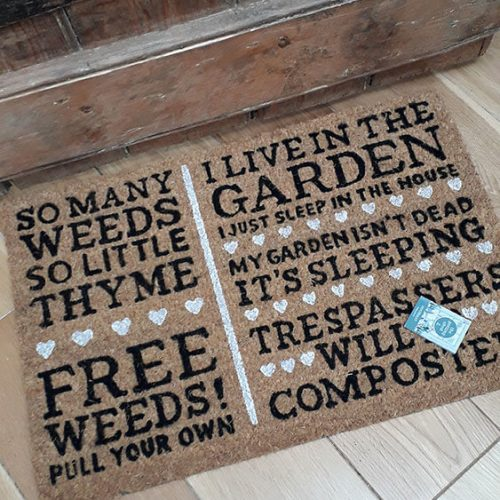 Door mats with various wording printed on them
