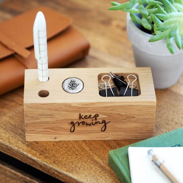 """Wooden rectangle desk organiser with the words """"keep growing"""" inscribed on it"""