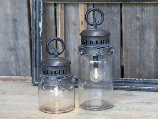 Two matching differently sized church style lanterns