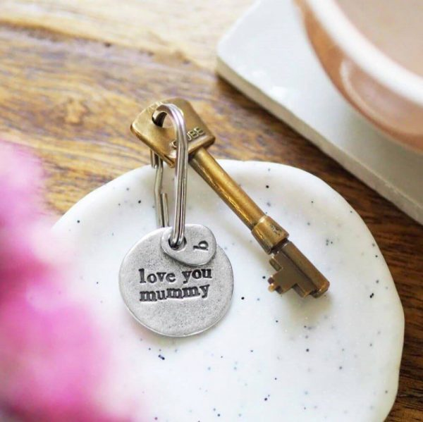 """Round metal keyring with """"love you mummy"""" inscribed on it"""