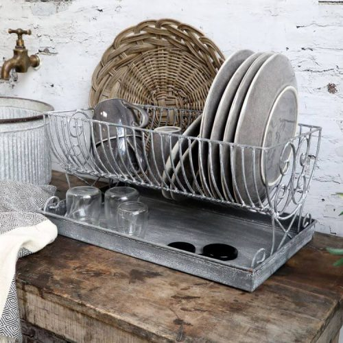 Metal dish drainer with a metal tray underneath