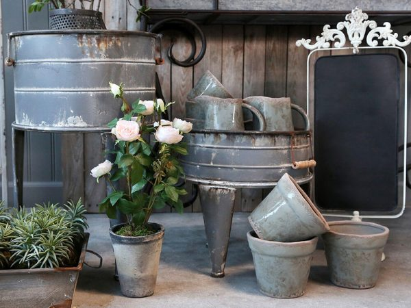 display of metal planters and plant pots