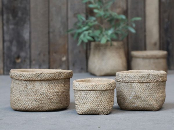 A plant pot with basket look effect with a rolled over top look