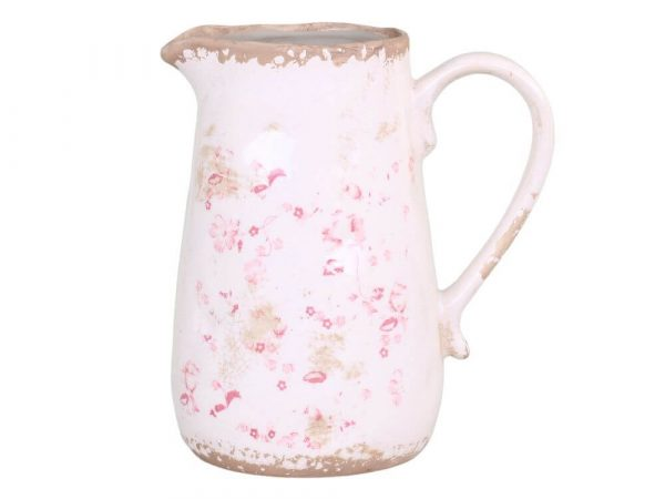 White jug with dainty pink flowers on it. Distressed effect around base and rim
