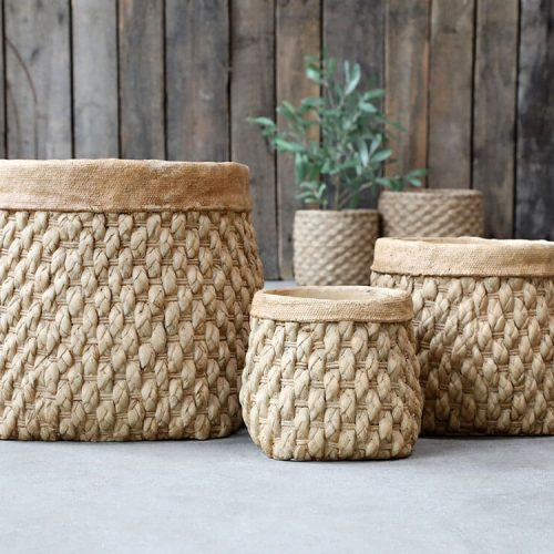 A natural coloured plant pot with a thick plain brim. The main part of the plant pot is a heavy weaved effect
