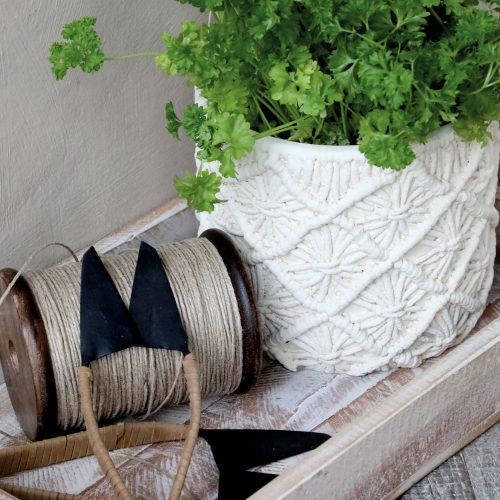 White plantpot with a braided detail