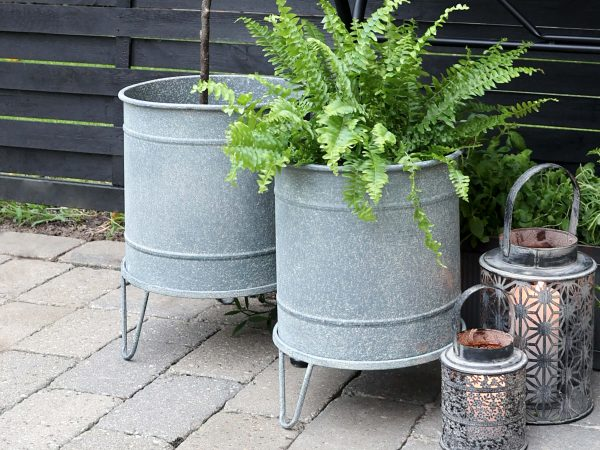 Two matching zinc planters, different sizes
