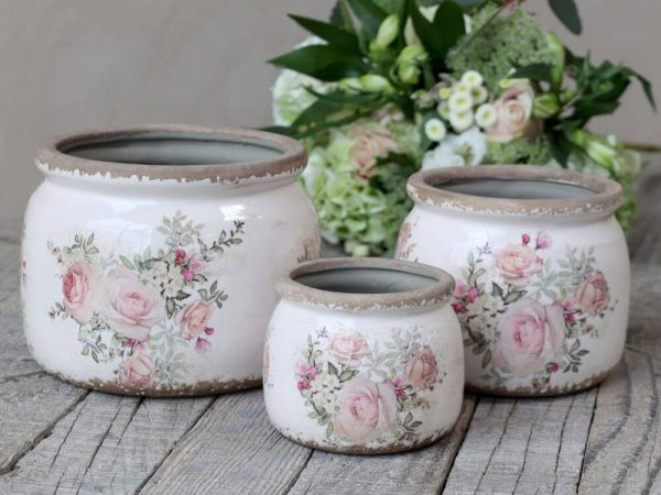 Set of 3 french plant pots with rose design on. All differing sizes