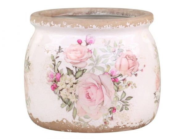 round plant pot with a rose design on the front. White background with a distressed effect around base and rim