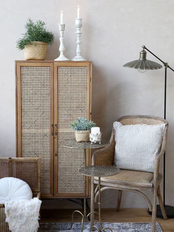 A display of a chair with a side table and lamp