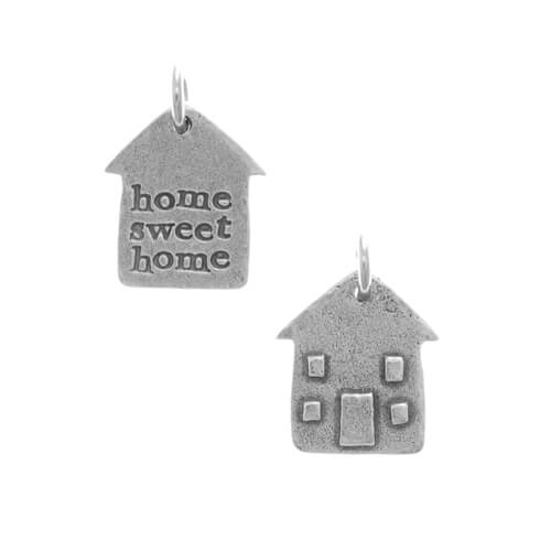 """Metal token in the shape of a house. One side has windows and doors incorporated and the other side has the words """"home sweet home"""" inscribed"""
