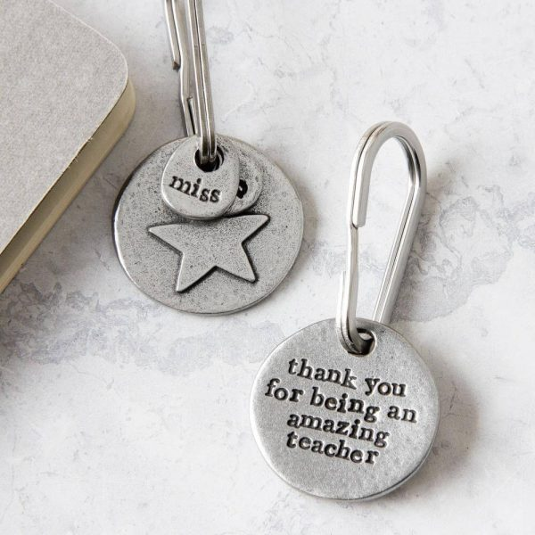 """Round metal keyring with a star on one side and the wording """"thank you for being an amazing teacher"""" on the other"""