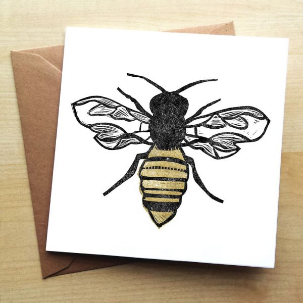 A plain card with a bumble bee on it
