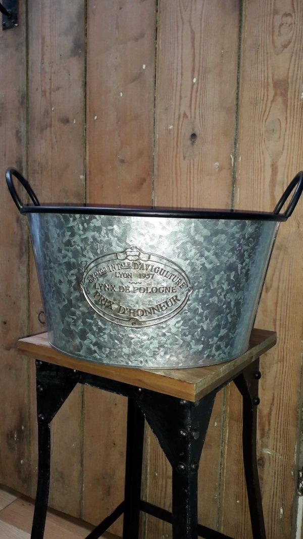 Galvanised planter with a darker rim and handles