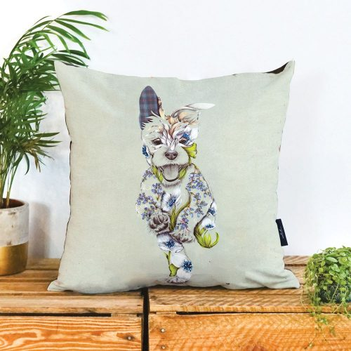 A cushion with a picture of happy running dog on it. The dog is a patchwork design made up of flowers.