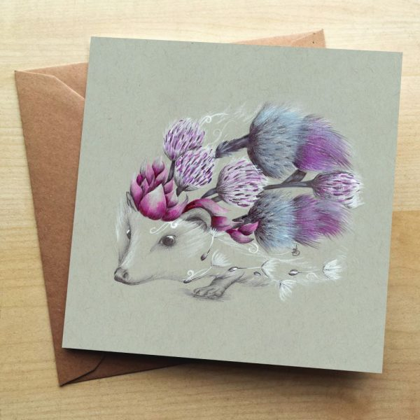 A card with a hedgehog. The bodywork of the hedgehog is made up on thistles