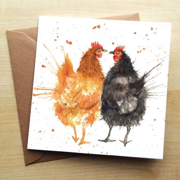 A card with a ginger and black chicken on with a splattered paint effect around them