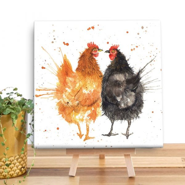A mini canvas with a ginger and black chicken on with a splattered paint effect around them