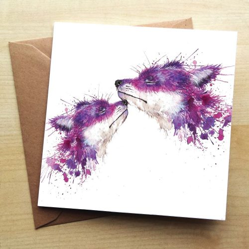 A card with 2 foxes on it, The foxes are purple made up of a splattered paint effect. The smaller fox is rubbing its nose at the chin of the larger fox