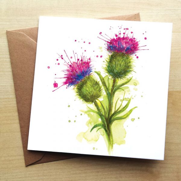 A card with a picture of 2 thistles on it