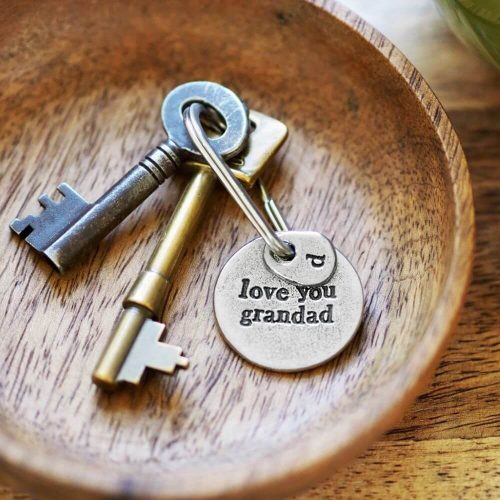 """Round metal keyring with """"love you grandad"""" inscribed on it"""