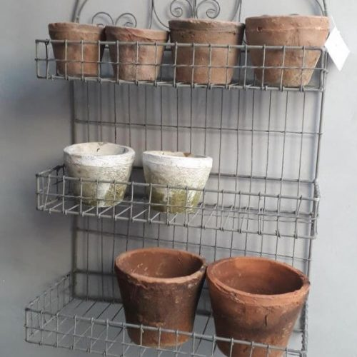 Wire storage rack with three shelves and a fancy arched design at the top