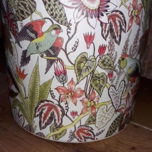 Plant pot full of colour, covered in flowers and birds