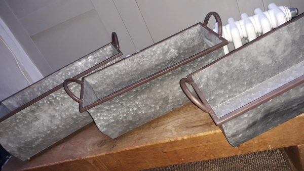 three zinc planters with a dappled look all with handles either side