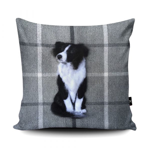 A grey tartan effect cusion with a black and white border collie in the middle