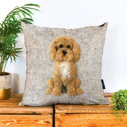 Natural coloured cushioin with a brown curly haired cockapoo on it