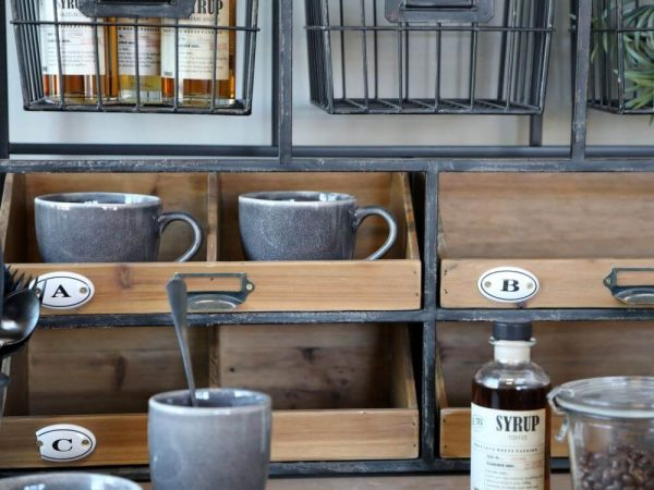 Kitchen shelving unit displaying cups