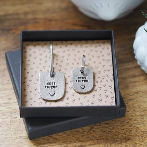 """Display box with 2 keyrings displayed in it both inscribed with """"best friend and a picture of a heart"""" one is to be attached to a dogs collar and the other is for the owners keys"""