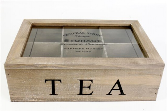 """Wooden box with a glass lid. """"TEA"""" is printed across the front of the box. There is 6 compartments within the box"""