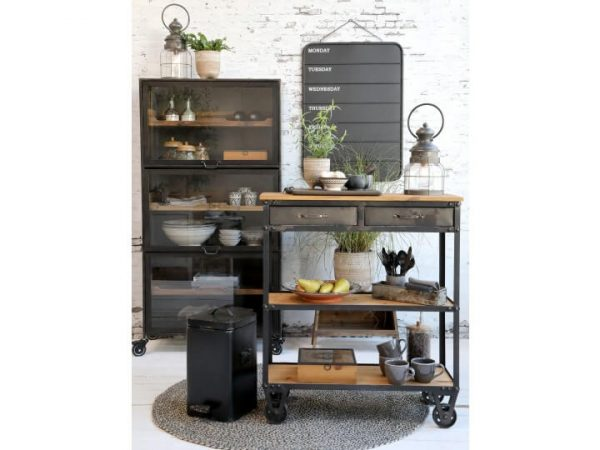 A kitchen island with a lantern displayed as an accessory