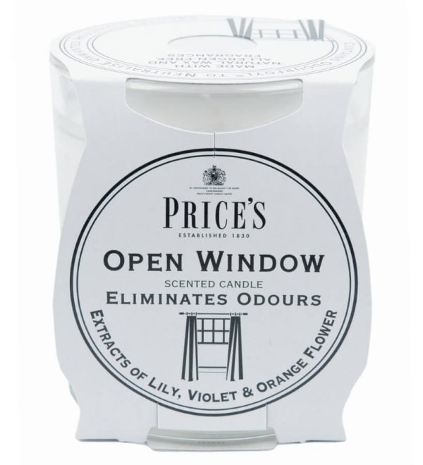 White candle in a glass jar. Candle is scented with extracts of lily, violet and orange flower