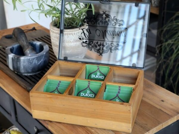 Wooden display box with lid open. Inside is 6 comparments displaying teabags