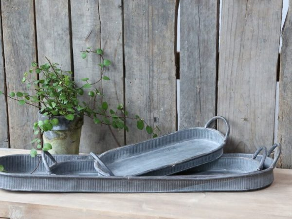Set of 3 oval metal serving dishes with handles. Matching, 3 different sized. Ribbed effect around the sides