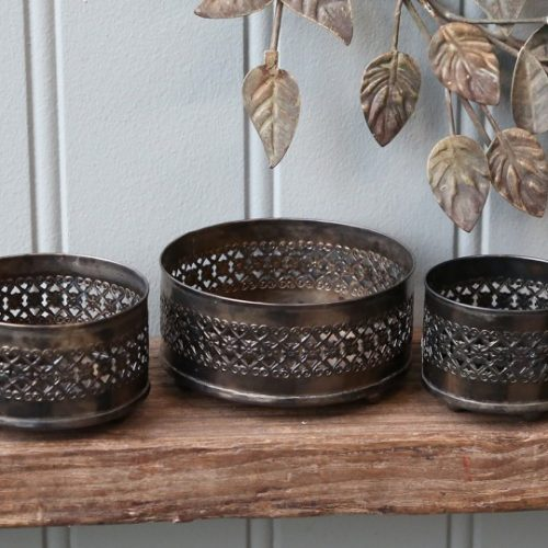 3 metal candle holders. Matching but different sizes