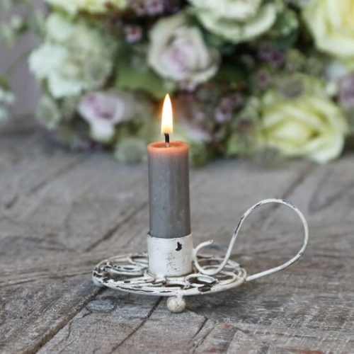 Candle holder with lit candle in for display