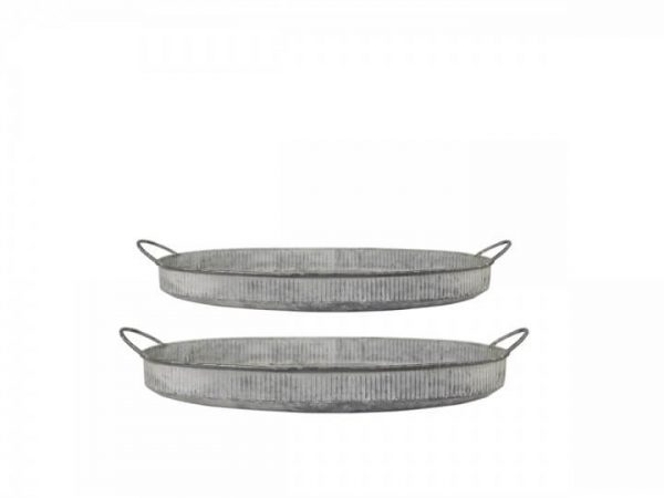 Two metal shallow round trays with a ribbed design and handles either side