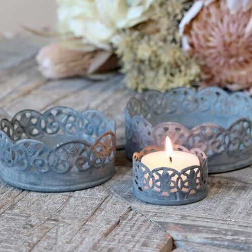 3 matching, different sized candle holder with a pretty rimmed design
