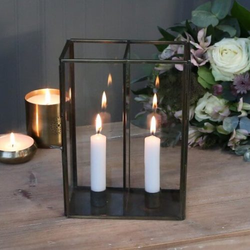 Cased glass candle holder with 2 lit candles in for display
