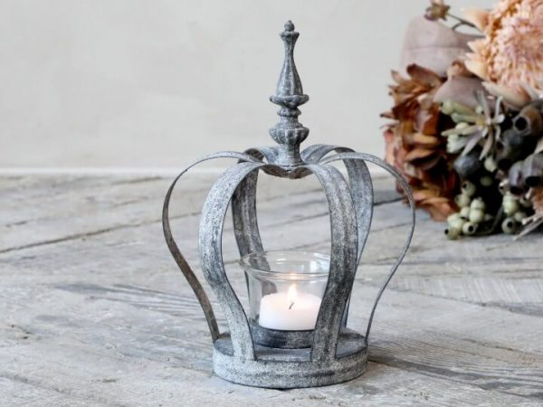 Metal crown design with a tealight holder in the centre