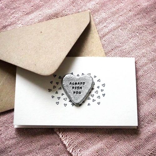 """Heart shaped metal token attached to a card with its envelope. Inscribed on the card is """"Always with you"""""""