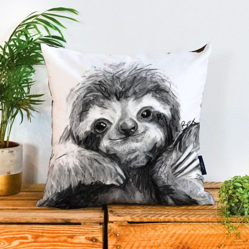 Square cushion with a neutral background with a charcoal grey and white sloth on it